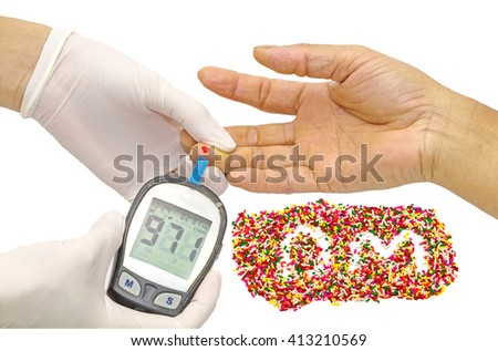 Blood sugar value is measured on a finger by  female doctor in white medical gloves and decorative sprinkles sugar in alphabet shape as DM on white background,(DM mean diabetes mellitus) - stock photo