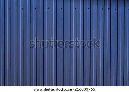 Blue corrugated metal fence as a background                          - stock photo