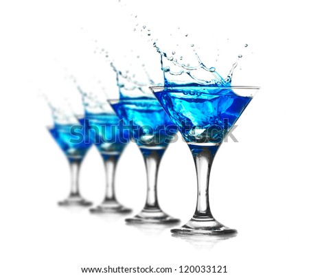 Blue curacao cocktail with splash isolated on white