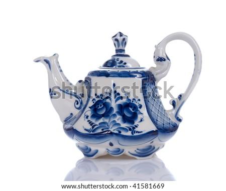 blue floral pattern tea pot on white background - stock photo