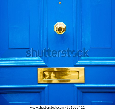 blue handle  in london antique  door  rusty  brass nail and light - stock photo
