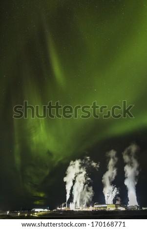 Blue Lagoon power plant with Aurora overhead - stock photo