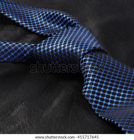 blue luxury tie on dark background - stock photo