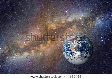 """""""Blue Marble"""" Earth planet on Milky Way background - stock photo"""