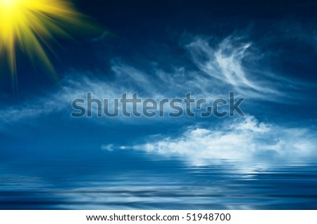 Blue sky and sun above of the sea.