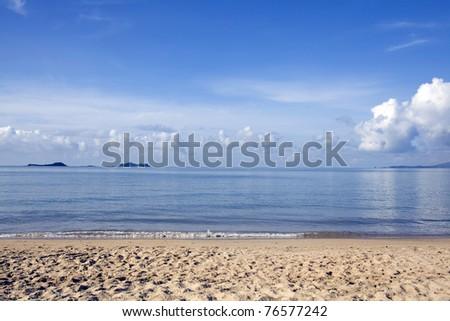 blue sky ,sea and sandy beach - stock photo