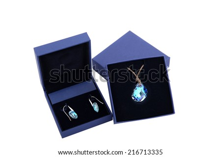 blue stone pendant and earring in blue present box isolated