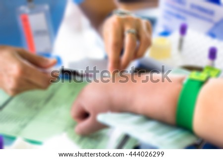 blur nurse pricked blood from a patient  - stock photo