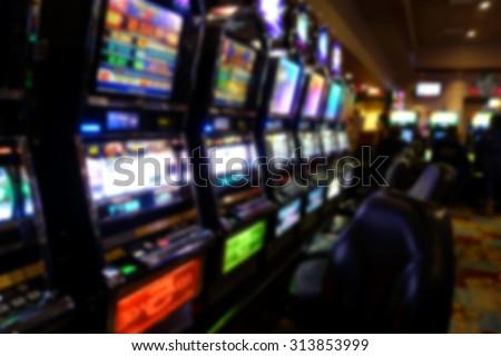 blurred background of casino slot machines                               - stock photo