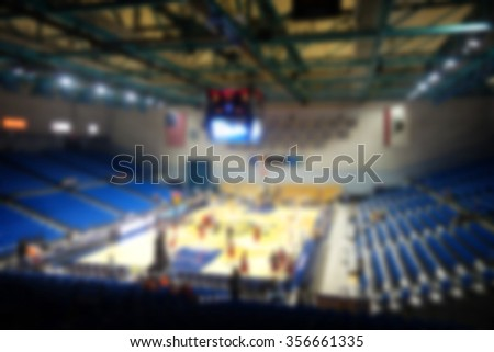 blurred background of nearly empty sports arena                             - stock photo