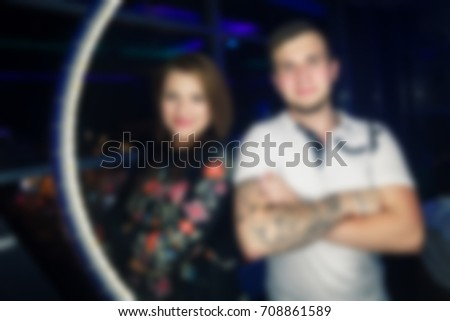 Blurred background photographing people at a party