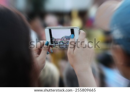 blurred people take photo - stock photo