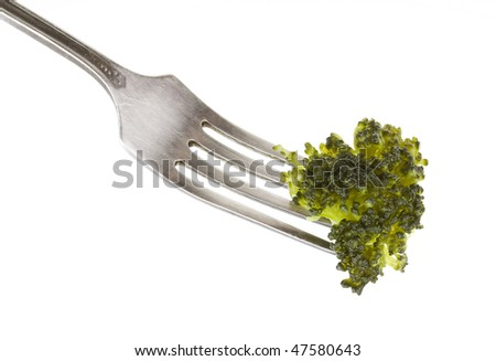 boiled cabbage broccoli on a fork against white background
