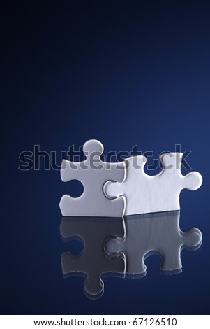 """Bonding"" of two puzzle pieces. - stock photo"