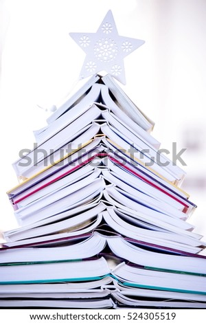 books shaped Christmas tree at home for Christmas holiday decoration, background close up