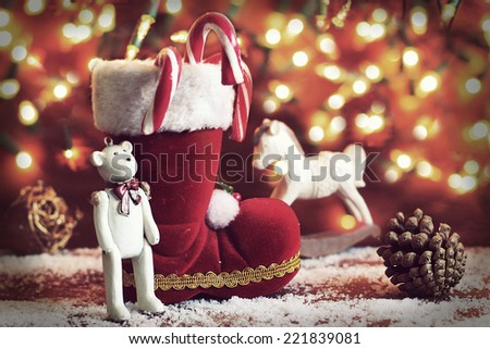 boots, rocking horse, and teddy bear on christmas background - stock photo