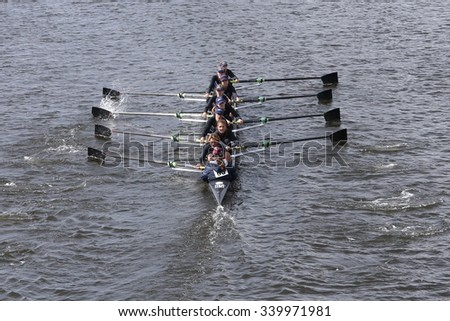 BOSTON - OCTOBER 18, 2015: Port Rowing races in the Head of Charles Regatta Women's Youth Eights [PUBLIC RACE] - stock photo