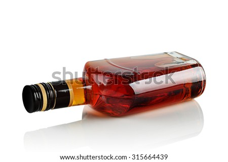 bottle of booze on a white background. - stock photo