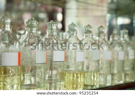 Bottles with essential oils at shop counter - stock photo