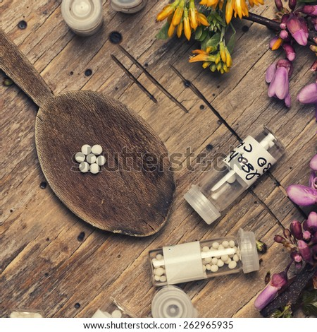 bottles with homeopathy globules and spoon - stock photo