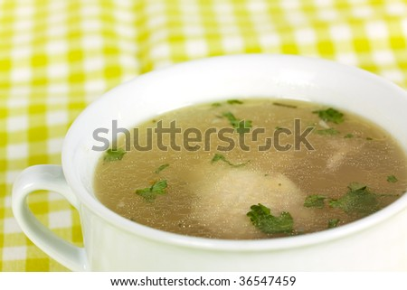 Bowl of chicken soup with selective focus