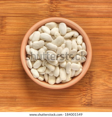bowl with dry white beans - stock photo