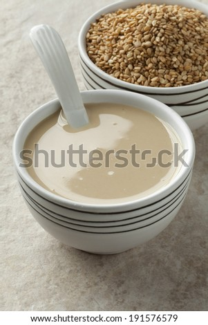 Bowls with tahini paste and roasted sesame seeds  - stock photo