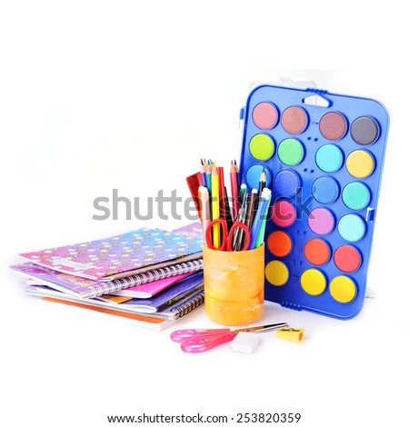 box with new watercolor paints, notebooks and other stationery facilities - stock photo