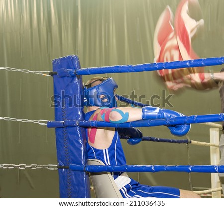 Boxing. Rest of the athlete in a break between rounds.  - stock photo