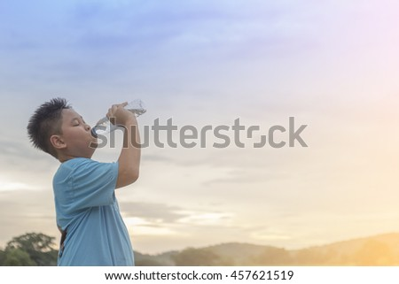 boy drinking water of outdoor.after fitness athlete.