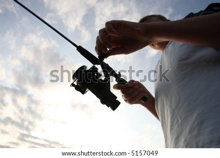 Boy Fishing at Sunrise