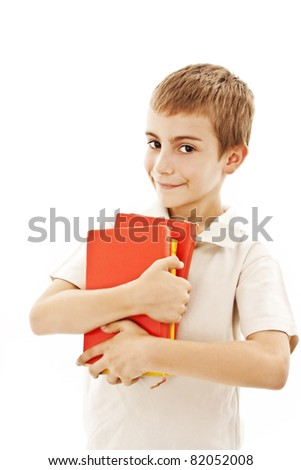 Boy holding colored books. All on white background. - stock photo