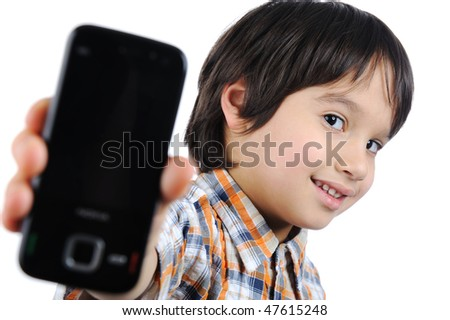 boy holding up cellular phone and smiling - stock photo