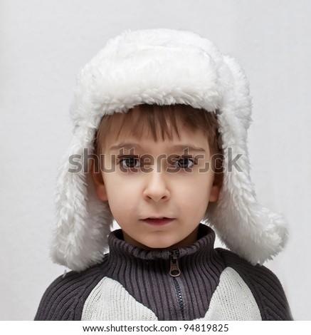 boy in winter hat - stock photo