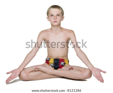 boy practicing yoga, healthcare concept   - stock photo