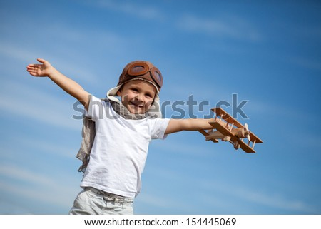 Boy with airplane on air fest - stock photo