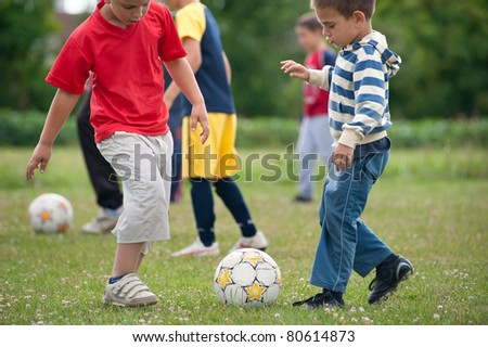 boys exercise soccer on the sports field - stock photo