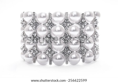 bracelet with pearls on a white background - stock photo