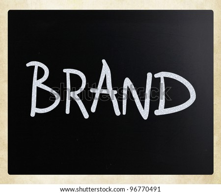 """Brand"" handwritten with white chalk on a blackboard - stock photo"