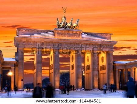 brandenburger tor in winter at sunset in berlin, germany - stock photo