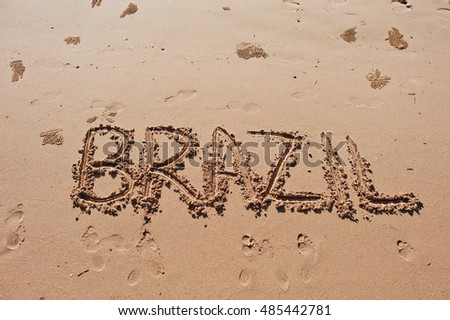 """Brazil"" written in the sand on the beach"