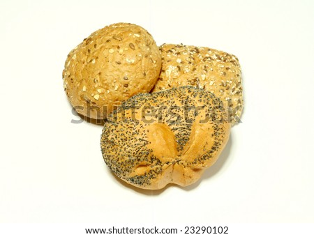 Bread rolls with sunflower seeds isolated on white background