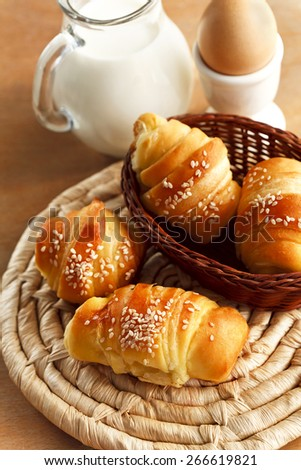 breakfast with fresh croissants and milk - stock photo