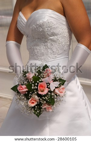 bridal bouquet in the hands - stock photo