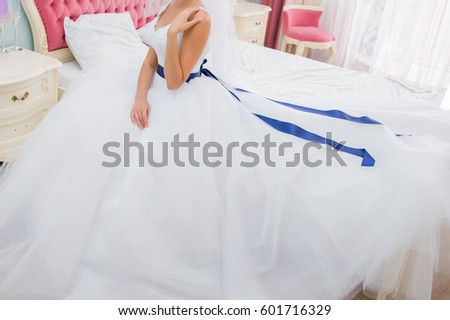 Bride in a dress on a bed