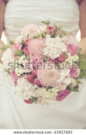 bride with pink roses bouquet - stock photo