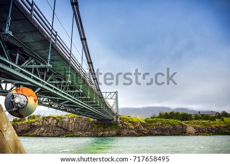 Bridge and picturesque Icelandic landscape.