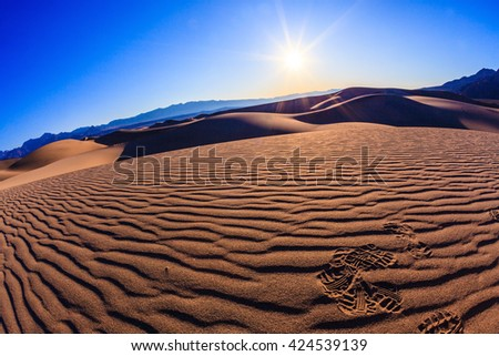 Bright solar morning in picturesque part of Death Valley, USA. Mesquite Flat Sand Dunes, Stovepipe Wells Village. Thin waves on sand - stock photo