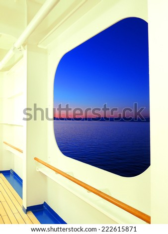 british columbia sunset as seen from a  promenade deck window on a princess cruise ship          - stock photo