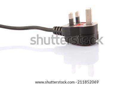 British Standard three pin AC power plugs over white background - stock photo